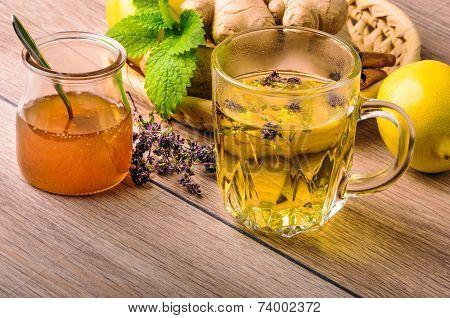 Still life with tea. Natural herbal tea with honey and lemon. Thymus serpillum. poster