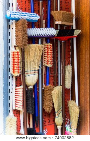 cabinet with various kinds of broom