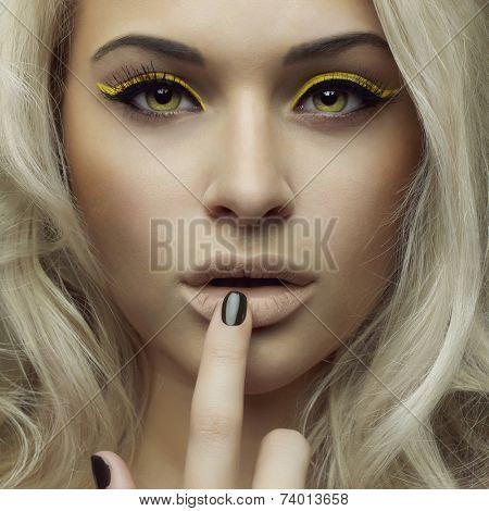 Fashion photo of beautiful woman with bright makeup
