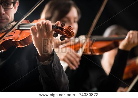 Violin Orchestra Performing On Stage