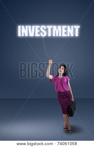 Woman Pulling A Text Of Investment