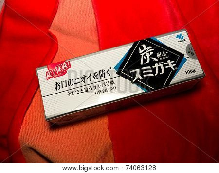 GOMEL, BELARUS - AUGUST 23, 2014:Japanese toothpaste Kobayashi with charcoal.Kobayashi Pharmaceutical Co., Ltd. manufactures and sells OTC pharmaceuticals, oral hygiene products.