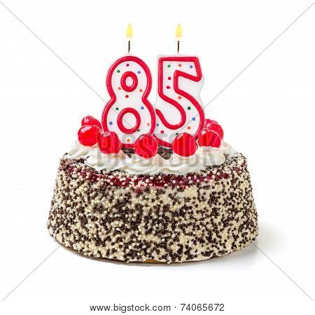 Birthday cake with burning candle number 85