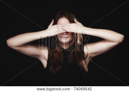 Teen Girl Covering Her Eyes On Black