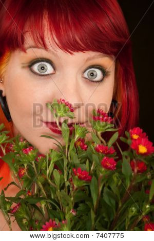 Pretty punky girl with brightly dyed red hair and flowers poster