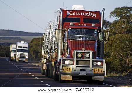 Several Large Trucks At Full Speed