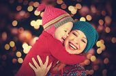 happy family mother and baby little daughter playing in the winter for the Christmas holidays poster