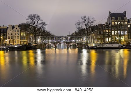 View of one of the Unesco world heritage famous city canals (Prinsengracht) of Amsterdam The Netherlands. poster