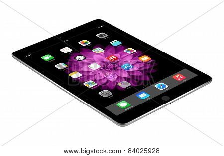 Apple Space Gray Ipad Air 2 With Ios 8 Lies On The Surface, Designed By Apple Inc.
