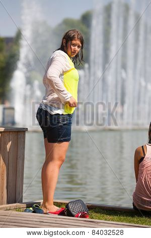 Fat Girl Standing On The Shore Of A Pond