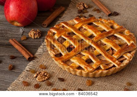 Apple Pie With Cinnamon On Retro Wooden Background