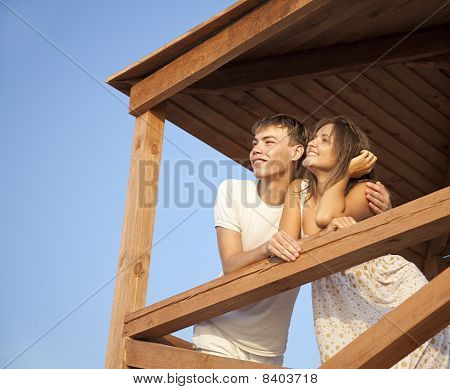 Two Lovers Looking Away. Outdoor photo from roof. poster