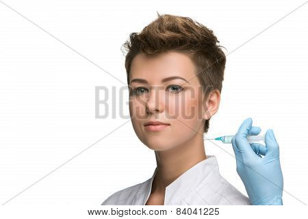 pretty young woman and vaccine syringe