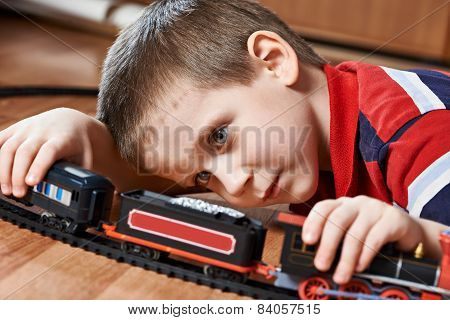 Little Boy Playing With Railway