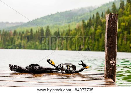 Snorkeling Mask and Tuba on Dock After a Dive poster