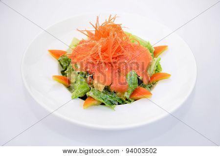 Smoke salmon caesar on white plate