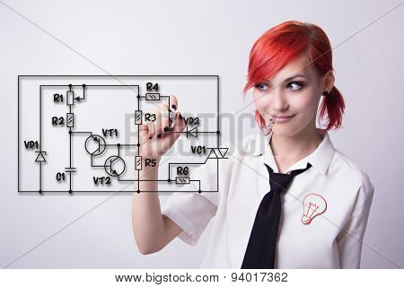 Red-haired girl circuitry draws marker wiring diagram electronic circuit in the form of a badge bulb piercings on his face he wrote marker tie and white shirt student doing homework. poster