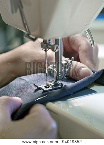 Hand Of  Woman Working With Old Sewing Machine