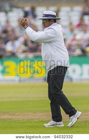 NOTTINGHAM, ENGLAND - July 14, 2013:  Umpire Aleem Dar signals for ground staff to carry out repairs during day five of the first Investec Ashes Test match at Trent Bridge Cricket Ground