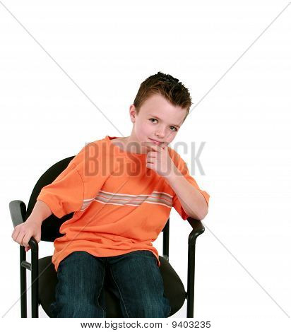 Seated Boy In Orange Shirt
