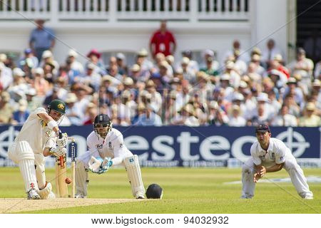NOTTINGHAM, ENGLAND - July 13, 2013: Ed Cowan hits the balland is caught by Jonathan Trott  during day four of the first Investec Ashes Test match at Trent Bridge Cricket Ground on July 13, 2013