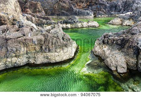 Swimming natural pools of volcanic lava in Porto Moniz, Madeira island, Portugal, Europe poster