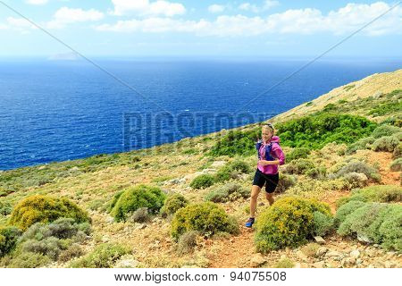 Happy Woman Cross Country Running In Beautiful Mountains