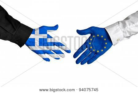 Diplomatic handshake between leaders from Greece and the European Union with flag-painted hands. poster