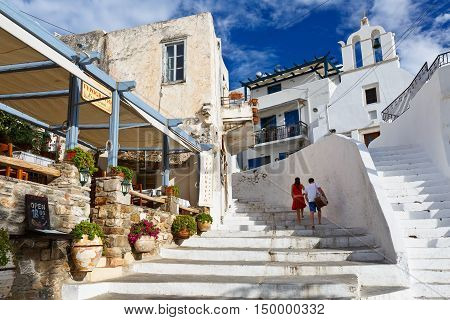 NAXOS, GREECE - SEPTEMBER 21, 2016: Restaurant and a church in the old town of Naxos on September 21, 2016.