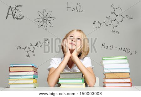 Cute girl with books. Chemical formulas on gray background. Education concept.