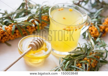 Tea With Sea Buckthorn And Honey On A Light Background.