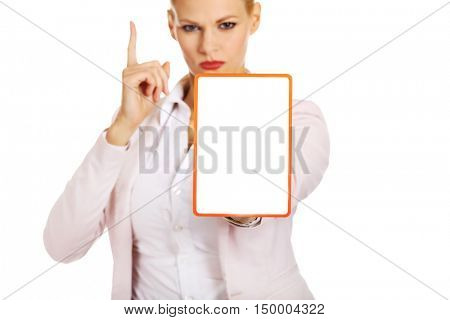 Young business woman holding a board with ban