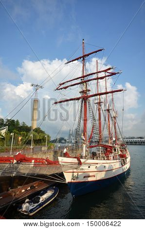 SINGAPORE - 02 OCT 2016: Royal Albatross Particulars cruise parks at Sentosa Singapore. Luxury Tallship Charter Royal Albatross offers a unique venue based in Singapore for celebrations corporate/private luxury yacht events and VIP's in style