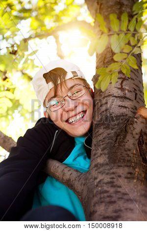 Happy Teenager Portrait on the Autumn Tree