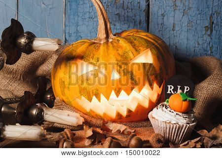 Halloween Pumpkin And Cupcake With Colored Decorations