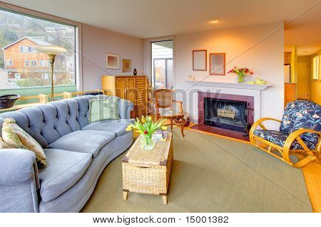 Living Room With Fireplace And Cozy Blue Sofa