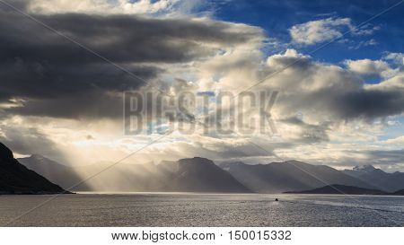 Sunbeams and clouds at the Hjorundfjord Fjordland Norway