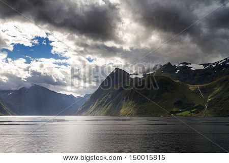 Dramatic landscape and cloudscape at Hjorundfjord Norway