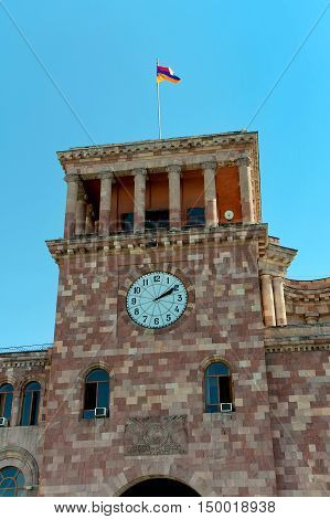 Yerevan. Armenia. Clock Tower and the national flag. vertical photo.