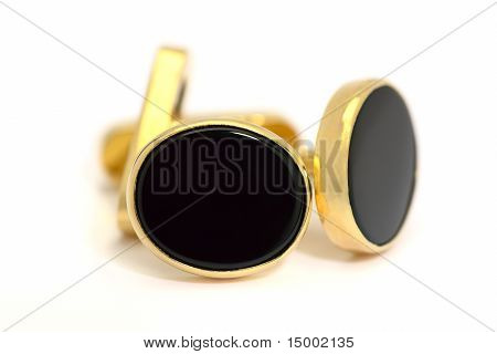 Formal Gold And Oval Black Onyx Cufflinks In Closeup On A White Background