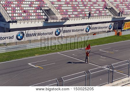 Moscow region, Russia - 27 August : route Moscow raceway man with a red flag on the Moto track before the race in day of Russian cinema 27 August, 2016.