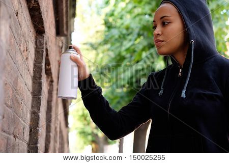 Afro-american Woman Using Spray Paint