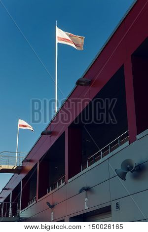 Moscow region, Russia - 27 August : route Moscow raceway tthe flags above the boxes where there are motorcycles and cars racers in day of Russian cinema 27 August, 2016.