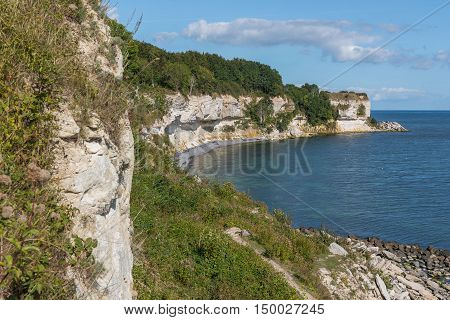 The white chalk cliffs of Stevns Klint on a sunny afternoon at the end of summer