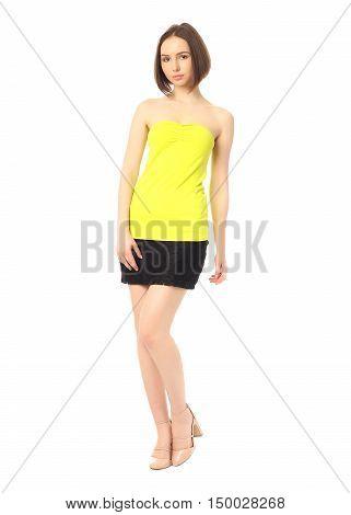 Fashion Model Dressed In Short Black Skirt Isolated On White