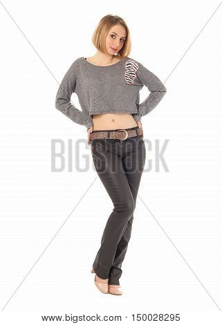 Girl Standing In Black Leather Pants In Studio