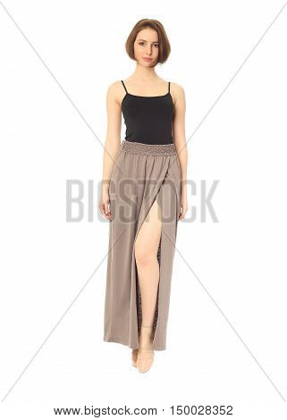 Fashion Model Dressed In Slit Beige Skirt Isolated On White