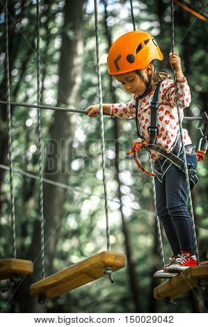 Sports Happy Kid Climbs Through The Ropes