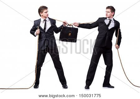 Twin brothers in tug of war concept isolated on white