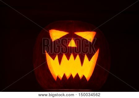 Jack-o-lantern for halloween closeup in night dark